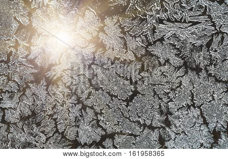 Ice patterns on glass on Christmas Eve. winter background