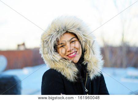 Pretty Hispanic Woman Smiling In A Winter Coat