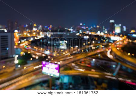 Blurred lights city highway overpass interchanged night view