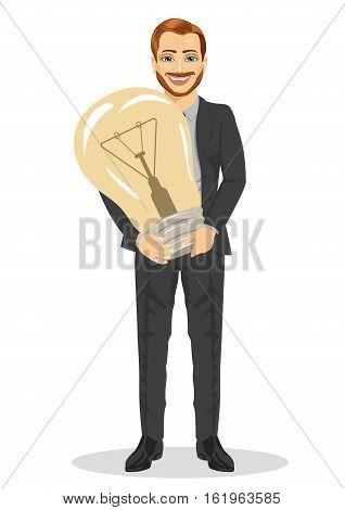 Young businessman holding big light bulb. Big idea concept