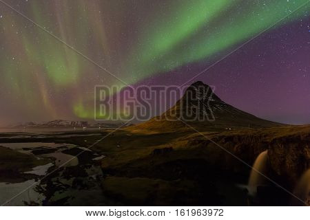 Northern Lights - Aurora borealis over Kirkjufell volcano, Iceland winter season landscape