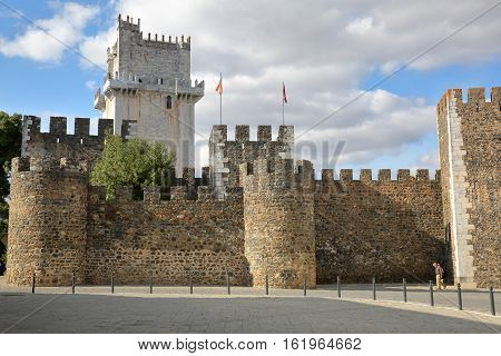 BEJA, PORTUGAL - OCTOBER 16, 2016: The castle and the tower with the cobbled pavement in the foreground