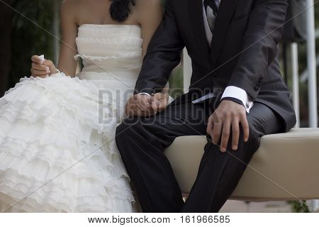 Woman and man holding hands in their wedding