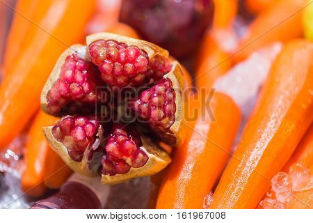 Selective Focus Of Pomegranate Fruit On Carrot Background For Prepare Making Juice Smoothie.