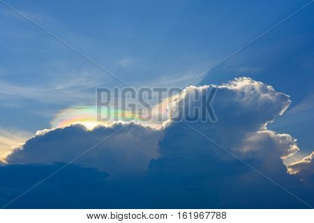 Iridescent Pileus Cloud on sky with colorful light