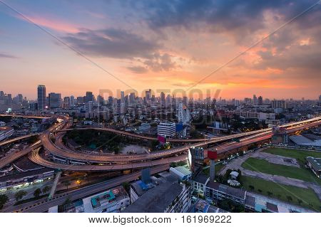 Sunset sky background over Bangkok city and highway interchanged, Thailand