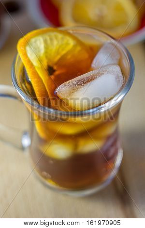 Glass Of Rum And Cola With The Ice Cubes And Slice Of Orange.