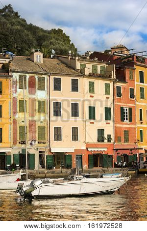 The village of Portofino with boats in the port and the colorful houses. Genova Liguria Italy