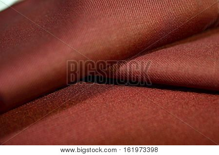 close up texture auburn fabric of suit photo shoot by depth of field for object