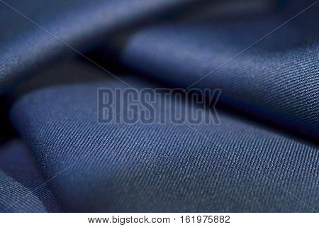 close up texture navy blue fabric of suit photo shoot by depth of field for object