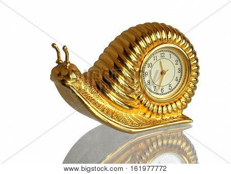 Snail retro gilded clock with a mirror reflection isolated on a white background