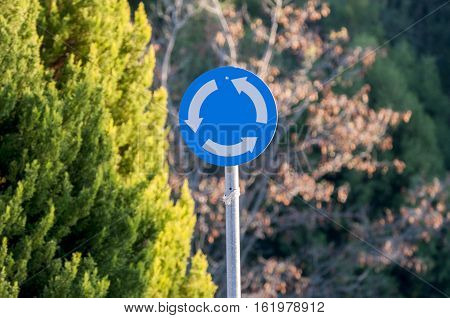 one circular roundabout metal sign, traffic, forest