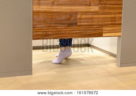 Woman Standing On Tip Toe In A Changing Room
