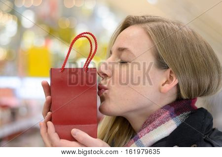 Pretty Young Woman Kissing Her Christmas Gift