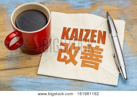 Kaizen - Japanese continuous improvement concept - word abstract on a napkin with a cup of coffee