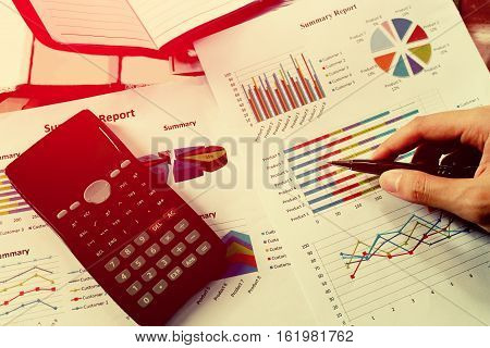 Business meeting man's hands pointing on charts.