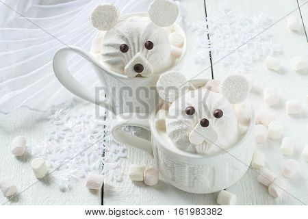 Hot chocolate with homemade original design in the form of polar bear out of marshmallow. The idea for children's Christmas party. DIY concept Merry Christmas and Happy New Year. Selective focus