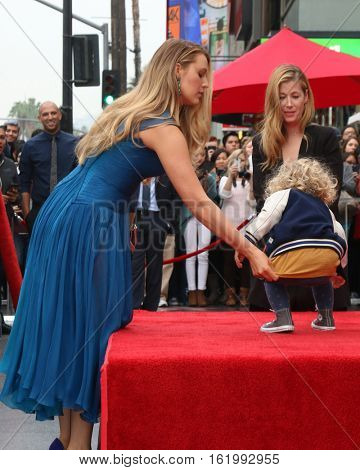 LOS ANGELES - DEC 15:  Blake Lively, James Reynolds at the Ryan Reynolds Hollywood Walk of Fame Star Ceremony at the Hollywood & Highland on December 15, 2016 in Los Angeles, CA