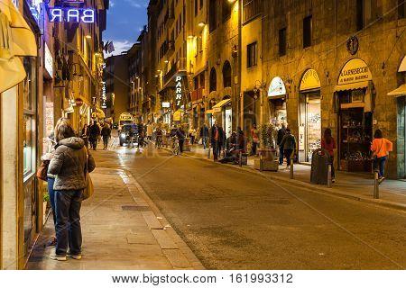 Tourists Near Shops On Via Guicciardini In Evening