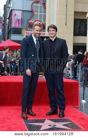 LOS ANGELES - DEC 15:  Ryan Reynolds, Nathan Fillion at the Ryan Reynolds Hollywood Walk of Fame at tbe Hollywood & Highland on December 15, 2016 in Los Angeles, CA