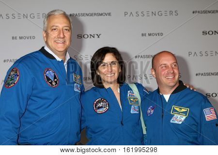 LOS ANGELES - DEC 14:  Mike Massimino, Nicole Stott, Garrett Reismanl at the