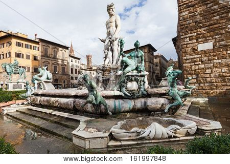 Wet Fountain Of Neptune In Florence City In Autumn