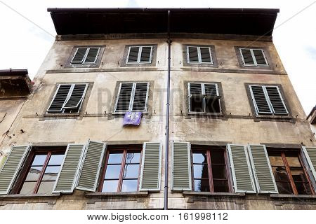 Facade Of Old House With Pennant In Florence City