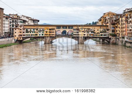 Muddy Water Of Arno And Ponte Vecchio In Autumn