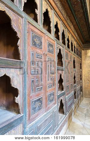 Cairo, Egypt - December 10, 2016: Embedded wooden ornate cupboard, in one of the rooms of Beit (house) of El Harrawi, an old Mamluk era historic house in Cairo, built in the eighteenths century