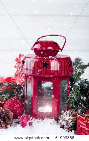 red lantern with snow background on white boards