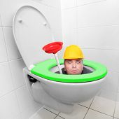 Funny repairman looking from toilet bowl with green seat in a modern bathroom. Homemade production of biomass and biogas. Environmentally friendly life in European Union. poster