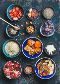 Ingredients for healthy breakfast over dark blue background, top view. Fresh and dried fruit, chia seeds, oatmeal, nuts, honey. Clean eating, vegan, vegetarian, healthy food, detox and dieting concept poster