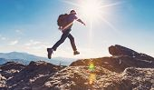 Man jumping over a gap high up on a mountain hike poster