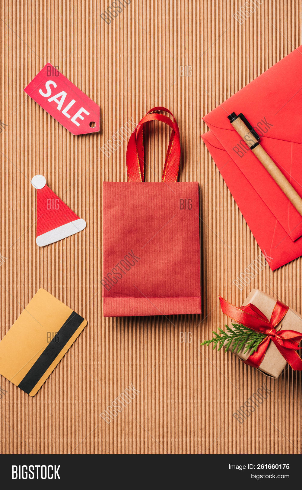 1ef4d241139b Top View Of Red Shopping Bag, Decorated Gift Box, Credit Card And Sale Sign