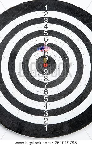 A Dart With Usa Flag On The Fletching Hits The Center Circle Of A Target