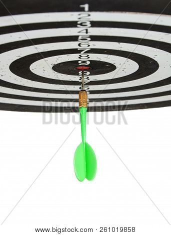 Green Dart In The Center Circle Of Target