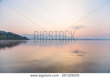 A Beautiful, Calm Morning Landscape Of Lake And Mountains In The Distance. Colorful Summer Scenery W