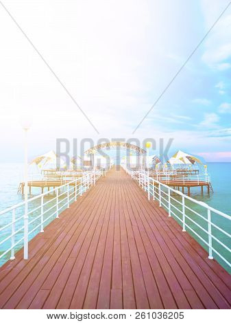 Summer Day On The Pier In The Ocean. Wooden Pier With Blue Sea And Blue Sky Background