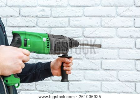 Use Hammer Drill To Drill The Wall. Close Up. Macro Photography.  Object