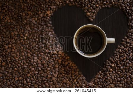 Coffee Cup And Coffee Beans On Table. Roasted Coffee Beans. Top View. Coffee Lovers.