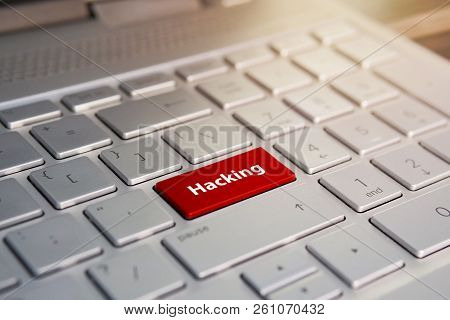 Russian Hacker Hacking The Server. Color Button On The Gray Silver Keyboard Of Modern Ultrabook. Cap