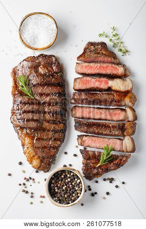 Two Grilled Marbled Beef Steaks Striploin With Spices Isolated On White Background, Top View