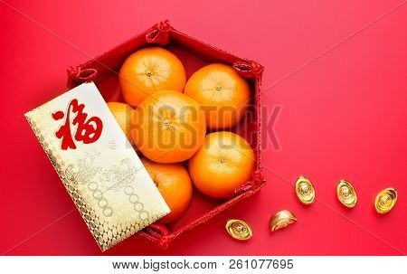 Group Of Orange Tangerine In Chinese Pattern Tray And Envelope Packet Ang Pow With Gold Ingots On Re