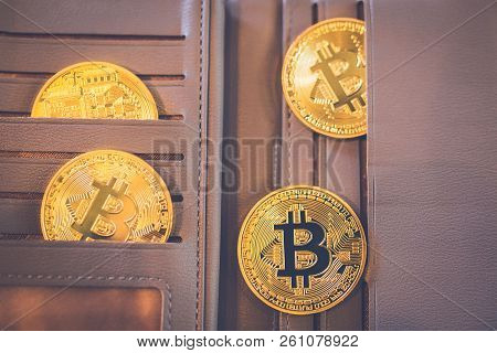 Bitcoin Gold Is Located In A Brown Leather Wallet.
