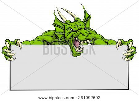 A Mean Looking Dragon Mascot Holding A Sign