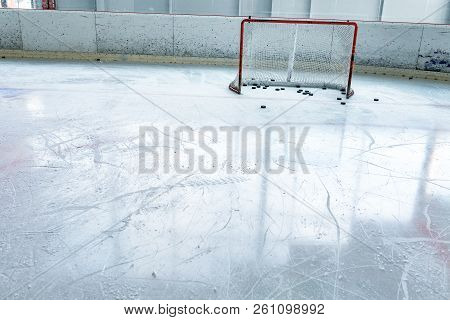Ice Hockey Ice Rink, Puck And Empty Red Net