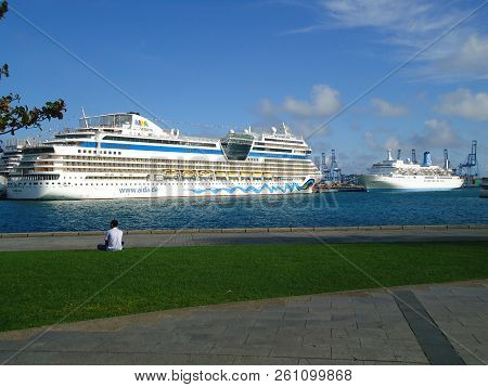 Canary Islands، Spain - December 7, 2013: German Cruise Ship Aida Stella And The Cruise Ship Thomson