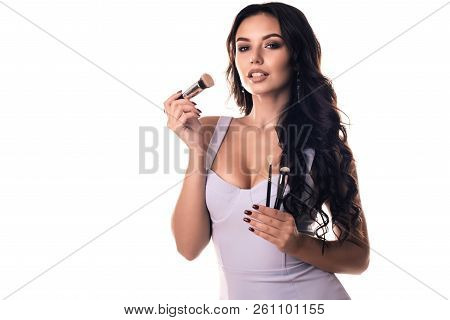Portrait Of The Beautiful Woman With Make-up Brushes Near Attractive Face. Adult Girl Posing Over Wh