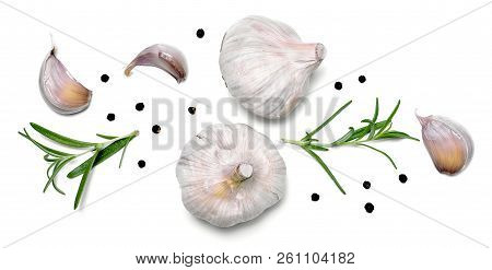 Beautiful Fresh Garlic With Black Peppercorns And Rosemary Branches. Group Of Objects Or Cooking Ing