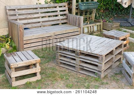 Vintage Wooden Recycled Palets Make Table And Bench In House Garden